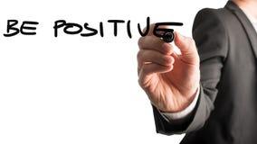 Geschäftsmannschreiben - seien Sie positiv lizenzfreie stockfotos