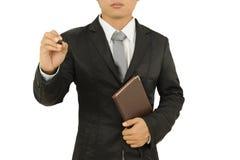 Geschäftsmannschreiben und Holdinganmerkungsbuch lokalisiert auf weißem Hintergrund Stockbilder