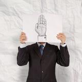 Geschäftsmannshowbuch der Hand angehoben Stockfoto