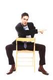 Geschäftsmannsitzen stockbild
