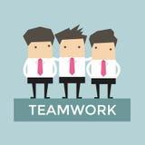 Geschäftsmannteamwork-Stand auf Podium Stockbilder