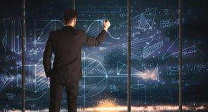 Geschäftsmannzeichnungs-Geschäftsdiagramme Stockfotos