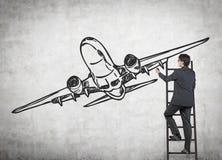 Geschäftsmannzeichnungsflugzeug Lizenzfreie Stockbilder