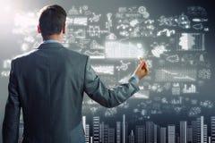 Geschäftsmannzeichnungsplan Stockbilder