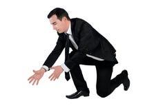 Geschäftsmannzupacken etwas Lizenzfreie Stockfotografie