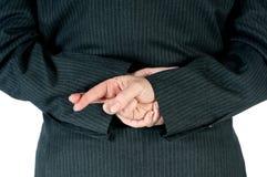 Geschäftsperson mit den Fingern nach zurück gekreuzt Stockfotografie