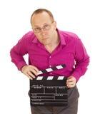Geschäftsperson mit einem clapperboard Stockfotografie