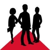 Geschäftspromischattenbild auf rotem Teppich Männlich-weibliche Leuteaufstellung Stockbilder