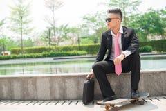 Geschäftsskateboardfahrer stockfotos