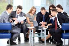 Geschäftsteam in der Sitzung Stockfotografie