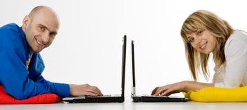 Geschäftsteam mit Laptopen Stockfotografie