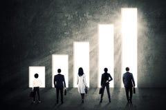 Geschäftsteam und steigendes Diagramm Stockfotografie