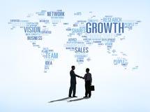 Geschäftsvereinbarungs-Erfolg mit Weltkarte Stockfotos
