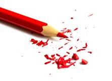 Geschärfter Bleistift und hölzerne Schnitzel Stockfotos