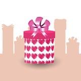 Geschenk im Kasten mit Herzen in Form eines Rohrs Stockbild