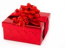 Geschenk-Kasten mit rotem Bogen Stockfotografie