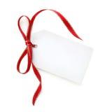 Geschenk-Marke mit Rot und Goldfarbband Stockbilder