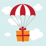 Geschenk mit einem Fallschirm Lizenzfreie Stockfotografie