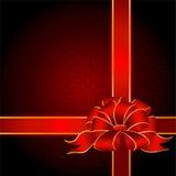 Geschenk mit einem großen roten Bogen Stockfotos