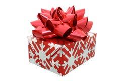 Geschenk mit großem rotem Bogen Lizenzfreie Stockbilder