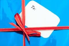 Geschenk mit Grußkarte Stockfotos
