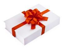 Geschenk mit rotem Bogen Stockbild