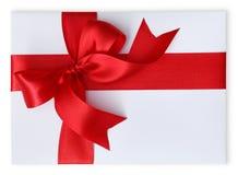 Geschenk mit rotem Bogen Stockfoto