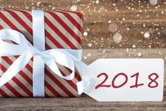 Geschenk mit Schneeflocken, Text 2018 Stockfotografie