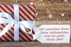 Geschenk mit Schneeflocken, Weihnachten Neues Jahr bedeutet Weihnachtsneues Jahr Stockfotografie