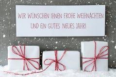 Geschenk, Schneeflocken, Weihnachten Neues Jahr bedeutet Weihnachtsneues Jahr Stockfotografie