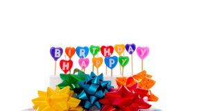 Geschenkbögen und Geburtstagkerzen Lizenzfreie Stockbilder