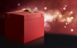 Geschenkbox über einem roten und schwarzen Weihnachtshintergrund Lizenzfreie Stockfotografie