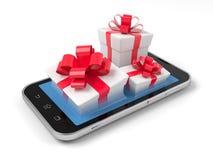 Geschenkboxen auf Smartphone Stockfotografie