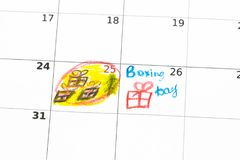 Geschenkboxen und Kalenderliste auf Holztisch 26. Dezember-Konzept Stockfotos