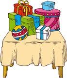 Geschenke auf dem Tisch Lizenzfreies Stockbild