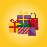 Geschenke auf einem gelben Hintergrund Stockfotografie