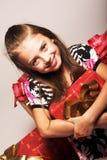 Geschenke des kleinen Mädchens und Weihnachten Lizenzfreie Stockfotografie
