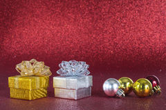 Geschenke mit Funkelnhintergrund Lizenzfreies Stockbild