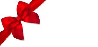 Geschenkgutschein mit rotem Bogen des Geschenks Stockfotografie