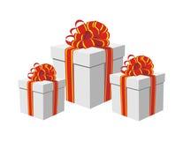Geschenkkästen mit den roten und goldenen Farbbändern lizenzfreie abbildung