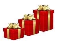 Geschenkkästen mit Goldbögen Stockfotos