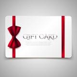 Geschenkkarte mit rotem Bogen Stockbilder