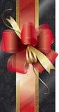 Geschenkkasten mit einem roten Bogen Lizenzfreies Stockfoto