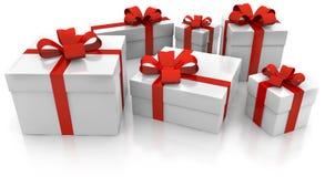 Geschenksätze mit rotem Band Stockbilder