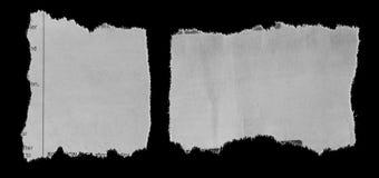 Gescheurde documenten op zwarte royalty-vrije stock afbeelding