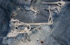 Gescheurde jeans met bergkristallen Royalty-vrije Stock Afbeelding