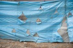 Gescheurde plastic dekking Stock Afbeeldingen