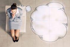 Geschäftsfrau auf Stuhl Stockfoto