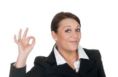 Geschäftsfrau, die okayzeichen zeigt Stockfotografie