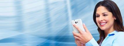 Geschäftsfrau mit einem Smartphone. Stockfotos